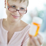 woman with pill bottle